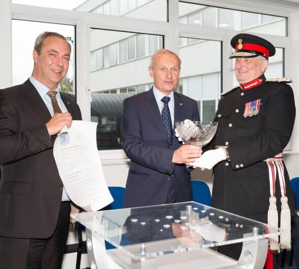 The crystal bowl being presented by the Lord-Lieutenant to Mr David Hall, CEO for Polypipe, and pictured left, Mr Simon Howard, MD at Polypipe Terrain, Aylesford, holding the Certificate. (c) Polypipe.