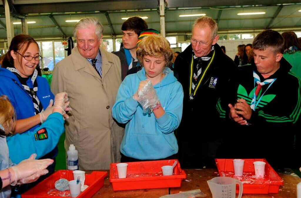 The Lord-Lieutenant and Kelvin Holford watch three young scientists in action