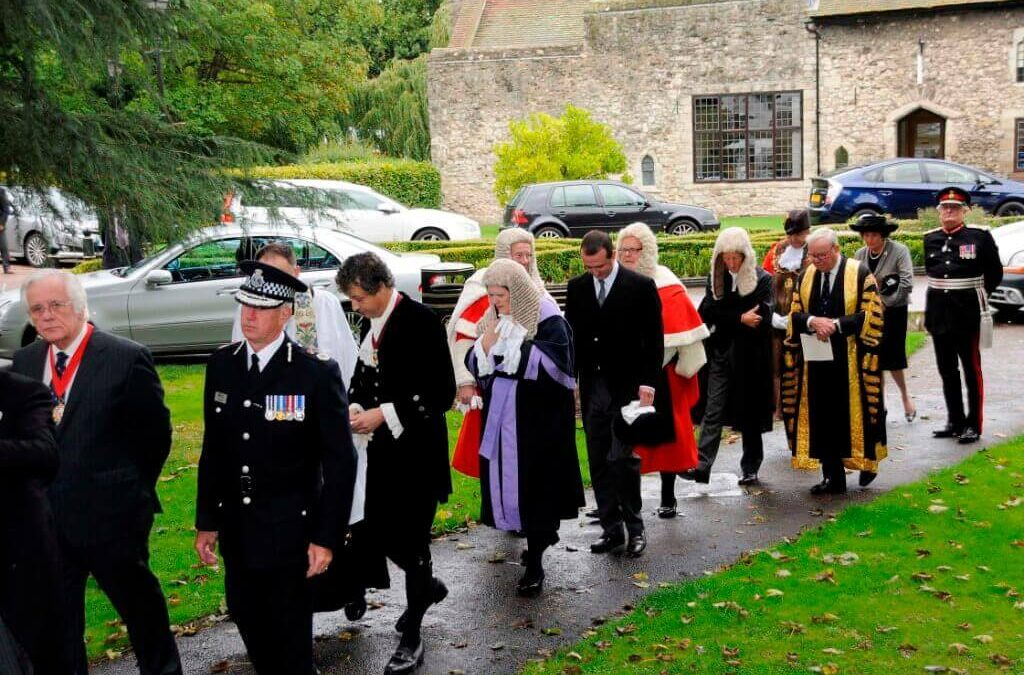 The procession enters All Saints Church for the service.