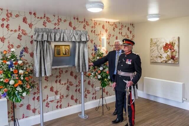 The Abbeyfield Kent Society's former Chairman, Bobby Barnes, and The Lord-Lieutenant of Kent, Viscount De L'Isle, unveil the plaque to celebrate the Care Home official opening. (c) The Abbeyfield Kent Society.
