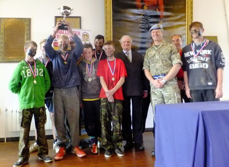 Viscount De L'Isle with Brigadier C J Clayton MBE MA Commander 2 (South East) Brigade and the winning team from The North School, Ashford, Kent
