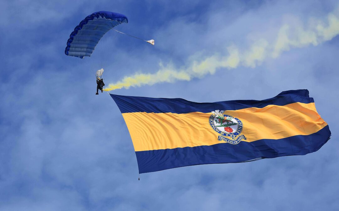 Regimental Flag descends from the sky aided by a Flying Tiger parachutist. (c) Barry Duffield DL.