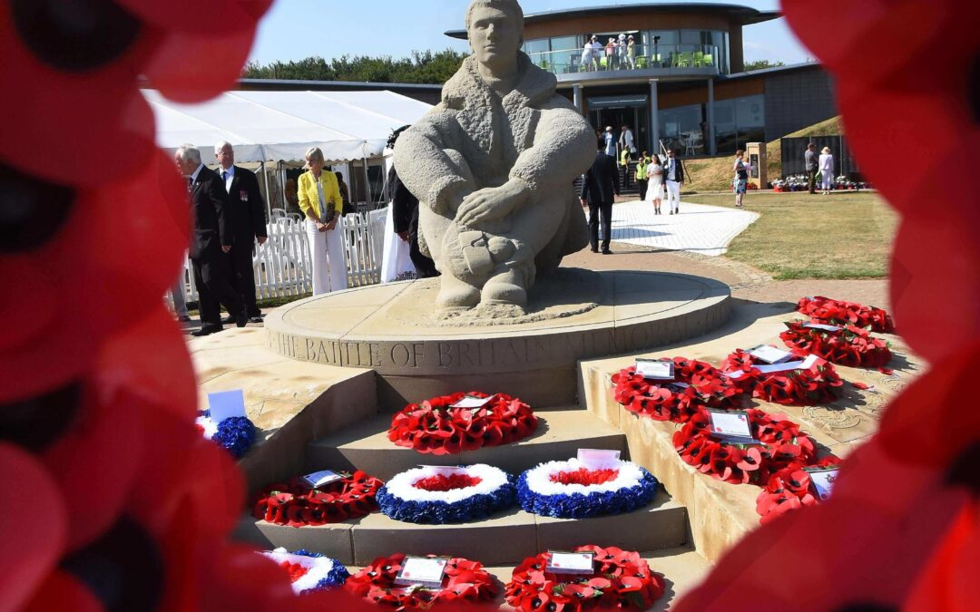 The atmospheric seated Airman Statue surrounded by moving tributes. (c) Barry Duffield DL.