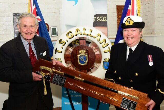 A/Sub Lt Jan Dean receiving the award from Commander Michael Casement. (c) Barry Duffield DL