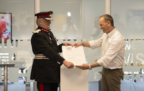 The Lord-Lieutenant presenting the certificate to Marco's co-founder Murray Hilborne. (c) Marco Ltd.