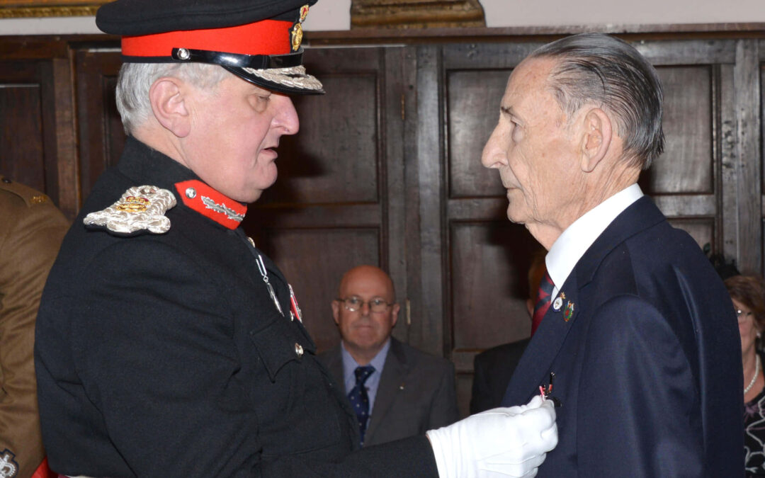 The Lord-Lieutenant presenting the BEM to Major (Ret'd) Bernard