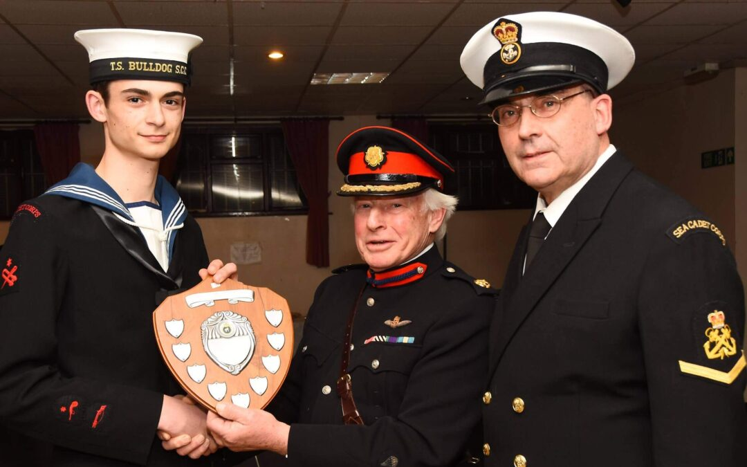 From left to right: Able Cadet Oscar Phillips, 17, receiving the Drill and Ceremonial Shield, Brigadier (Retd) David Ralls DL and the Unit's Officer in Charge Petty Officer (SCC) Martin Phillips. (c) Barry Duffield DL.