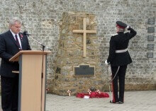 The Lord-Lieutenant laying his wreath at the Memorial in the Garden of Honour. At the lectern is Mr Geoff Humphries, Vice Chairman of the Royal British Industries Village Branch.(c) Nadine Smith.