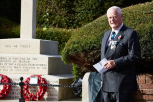 Teston War Memorial on Remembrance Sunday where Lieutenant Colonel Richard Dixon TD DL unveiled a plaque and gave a short address on behalf of the Lord-Lieutenant.