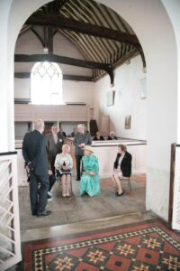 The Princess takes time to hear more on St Clement, Old Romney by her guide for the day, John Hendy.(c) Ian Hamilton.