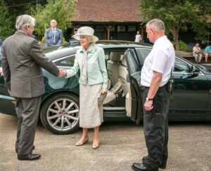 Princess Alexandra being greeted by the Lord-Lieutenant on arrival at Leeds Castle. c) Leeds Castle.