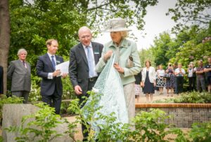 Princess Alexandra unveiling the plaque for the new Princess Alexandra Garden, with from left to right: The Lord-Lieutenant, Viscount De L'Isle; Sir David Steele, Leeds Castle Chief Executive and Mr Niall Dickson, Leeds Castle Foundation Chairman. (c) Leeds Castle.