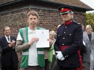Stephen Wakeford receives the official documentation from the Vice-Lord-Lieutenant.